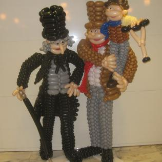 Scrooge and Tiny Tim Balloon Sculpture